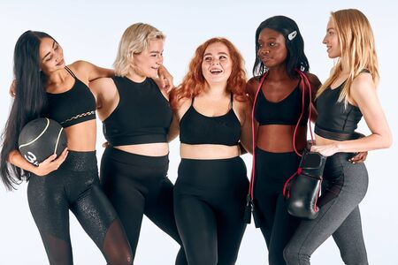 Portrait of multi-ethnic group of slim girls, different size and appearance. Sportive and beautiful