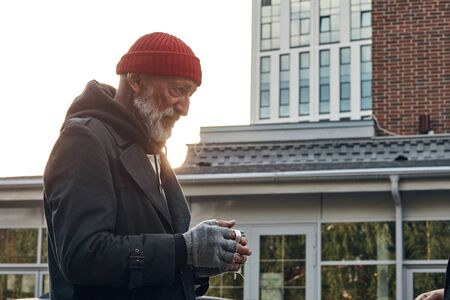 Vagrant man collect money for shelter, food. Life depends on money. Homeless person on street