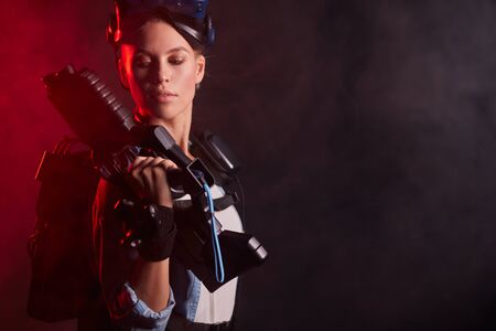 Portrait of woman amateur of virtual reality game, fight in process, professional shooter vr