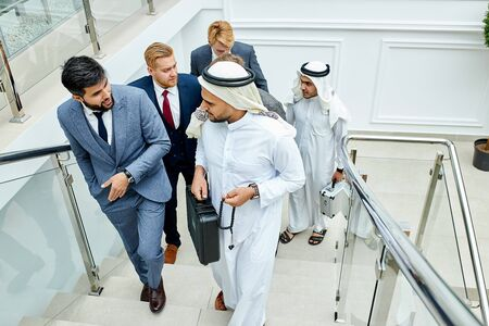 Sheikh holding black case and speak. Rich men make business deal Stock fotó