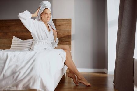 Young beautiful woman having pleasant morning in comfortable room.