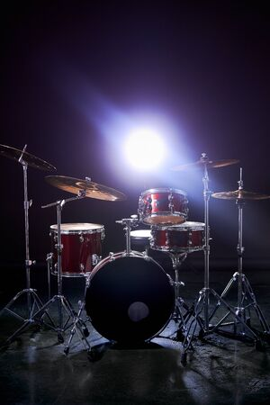professional drum set instruments in dark studio with lights . music, instruments, hobby concept