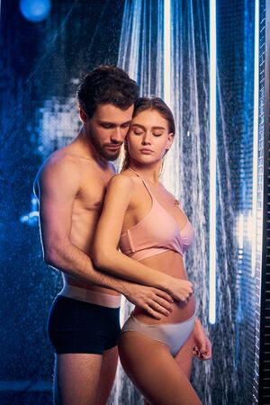 nice caucasian couple stand together isolated in shower room, naked woman and man wearing only underwear. clean and fresh, happy after enjoyable spending time together in bathroom Stock fotó