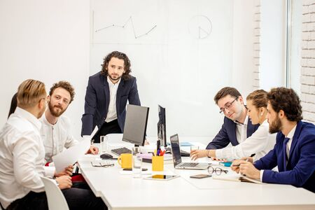 young caucasian people gathered in office to discuss business projects and ideas, wearing formal wear isolated in modern office. diverse enthusiastic people in boardroom