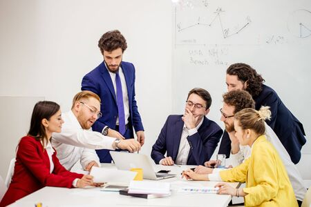 diverse young people in formal wear have conversation, communicate with each other in boardroom, discuss deadline of project and how to reach best results