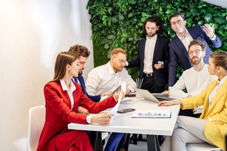 active discussion of business project in office, confident people enjoy working, cooperating together, everyone in formal wear Banco de Imagens