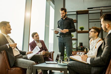 teamwork of young caucasian bearded leaders in modern office, successful and effective coworking of business group consisted only of men