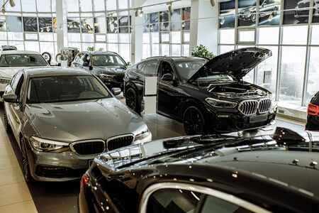 beautiful black cars of business class stand in dealership, waiting for their future owners. automobile, cars. vehicle, dealership concept Stock Photo