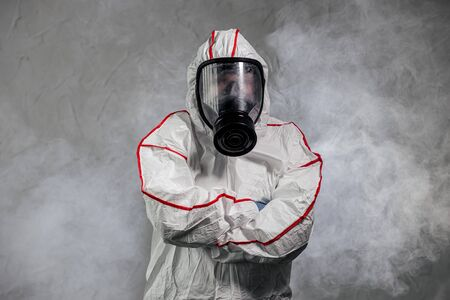 male in protective hazmat suit and gas-mask against coronavirus, disinfect areas, pathogen respiratory quarantine coronavirus COVID-19 concept