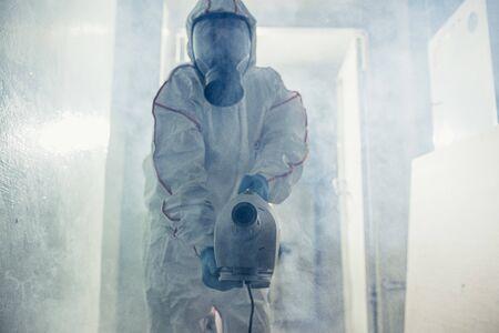 male in protective hazmat suit and gas-mask against coronavirus, disinfect areas, pathogen respiratory quarantine coronavirus COVID-19 concept Reklamní fotografie