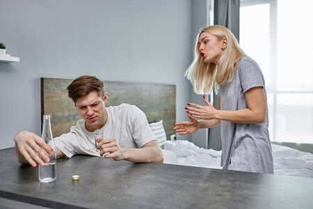 woman does not know what to do with this mediocre husband an alcoholic, man spending all family savings on alcohol, his wife gives up, at a loss
