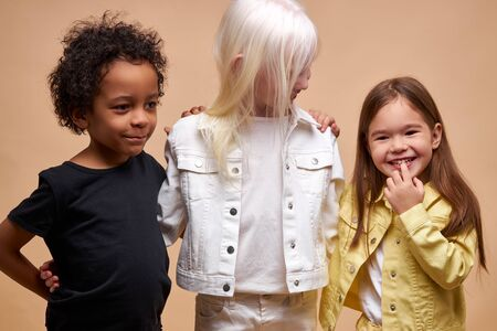 portrait of diverse beautiful kids. albino, african and american children together. diverse appearance is not a hindrance for the friendship of children