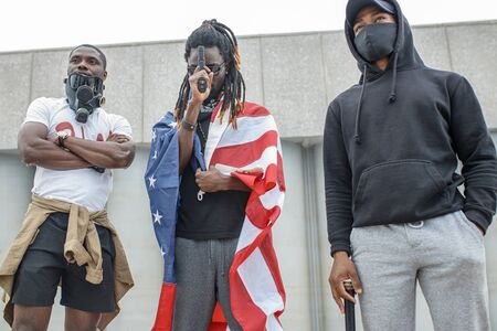 portrait of young armed afroamerican men on demonstration, independent citizens go to protest and defend rights of black people