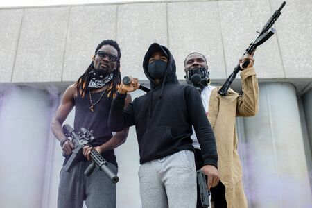three black men with guns ready to shoot if discrimination does not stop, they are dissatisfied with the attitude of white people to them