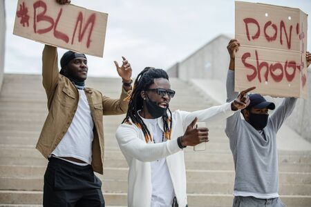 black people all over the world showed up for rallies to show their solidarity with the Black Lives Matter movement. they want to be heard, fight with injustice Imagens