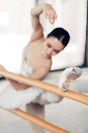 athletic and flexible woman attending ballet classes. close up photo.
