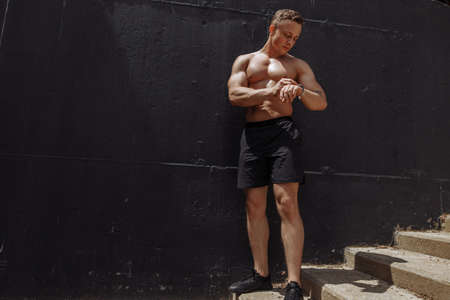 Crossfit attractive caucasian athlete running upstairs warming up before crossfit training outdoors. Male runner jogging workout wellness concept. Healthy lifestyle, sport and people.