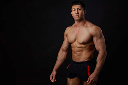 Strong Athletic man with perfect body. isolated on black background with copyspace. free time, lifestyle concept