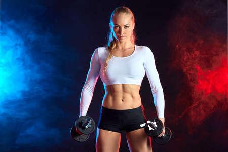 serious confident gorgeous athlete woman is fond of sport. motivation concept. close up photo. Banque d'images