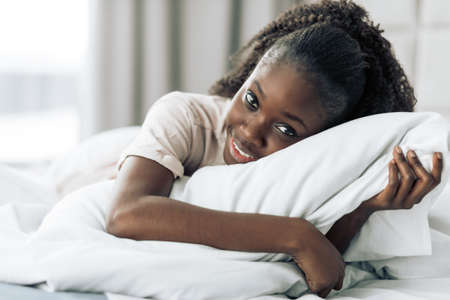 happy carefree girl hugging her pillow. close up photo.love. girl fell in love .