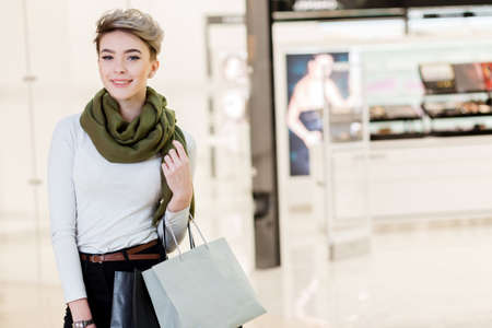 Portrait of  young woman shopping.