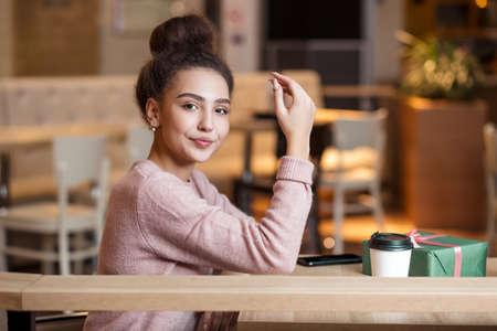 Portrait of  young woman having coffee. Foto de archivo