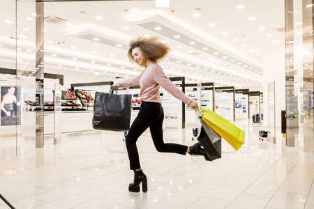 Portrait of young woman shopping. Archivio Fotografico