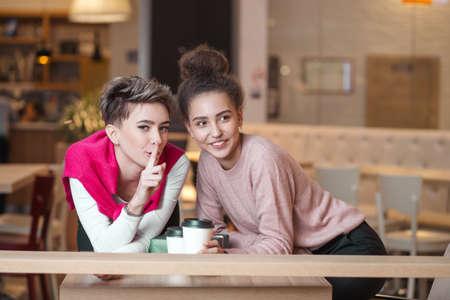 Portrait of two young woman having coffee. Foto de archivo