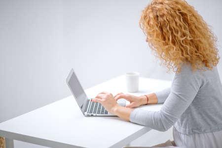 Woman using laptop background.