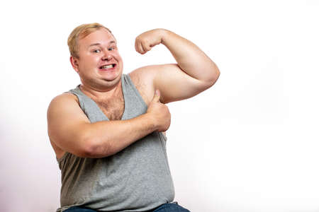 Fat man showing muscles background. Stock Photo
