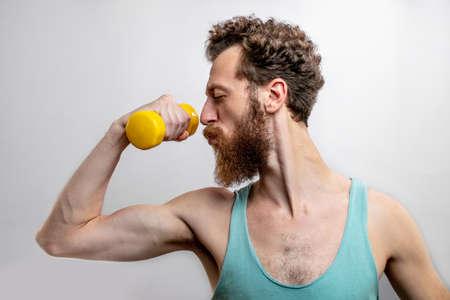 Man holing dumbbell background. Stock fotó