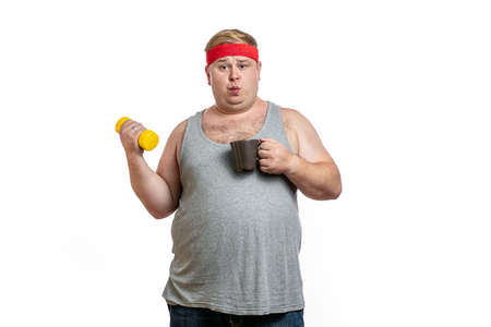 Fat man exercise using dumbbell