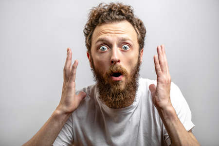Surprise man close up background. 免版税图像