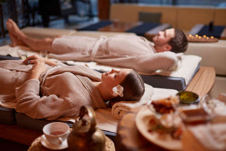 Young caucasian husband and wide take pleasure, take rest together in spa center, relax and rest of whole body