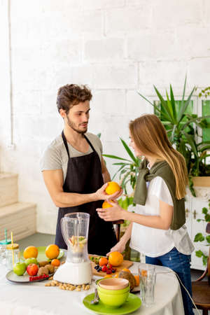 young cheerful man is offering to a girl to grab a bite. close up photo