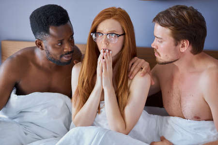 girl woke up with two diverse men, she is in shock, redhead woman does not remember with whom she spent the night with