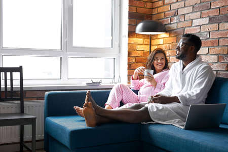 husband and pregnant wife in modern room interior.