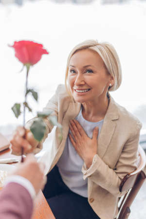 romantic moment, lovely fair-haired woman is being congratulated by her admire. gratitude. Thank you