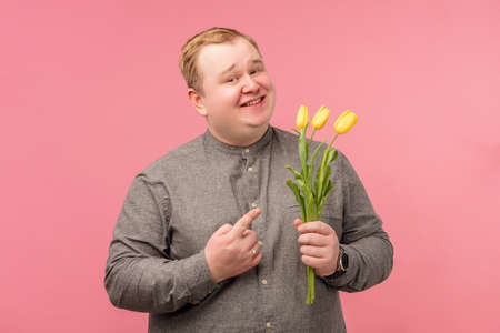 Man holding flowers background.