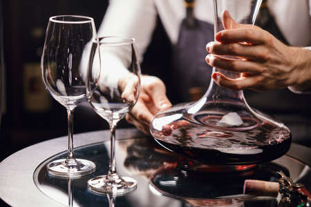 Staff training for sommelier experts. All that is needed is wine etiquette, the rules for buying wine for the customer, decanting and pouring wine into glasses.
