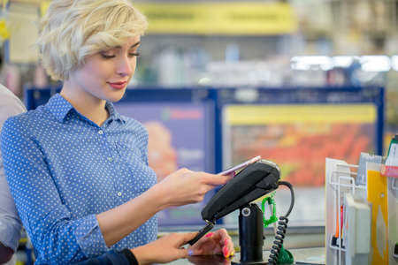 it could be much more easier for young people, youngsters, to check out at the grocery counter, retailer, with credit card. People and technology concept.
