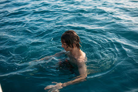 Young man bathing at the open sea. leisure and fun