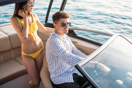 the Young couple navigating on a yacht Standard-Bild