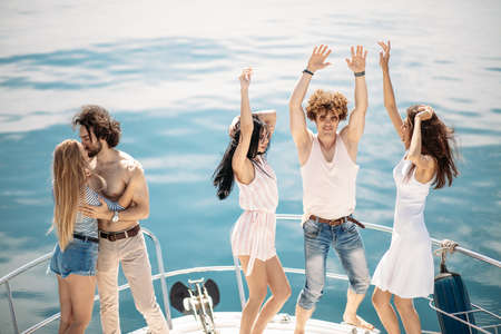Young yoyful people having fun in boat party - Happy friends enjoying sea trip to islands. Marine Cruise, Travelling and Vacations