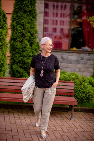 a beautiful woman is leading a healthy lifestyle. mature female is spending time in the street