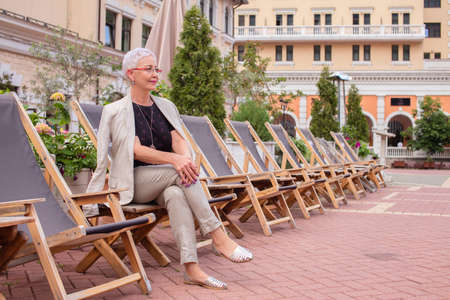 confident stylish old woman sitting with crossed legs. confidence and success concept.rest time