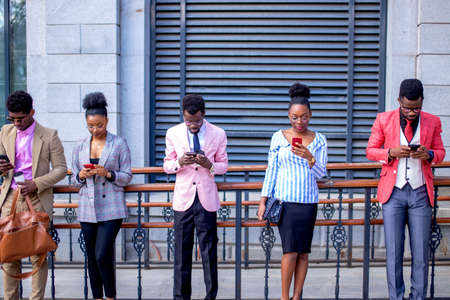 young people cant imagine their life without mobile phones. twitter, facebook concept. amazing breathtaking online game. everybody uses smart phones