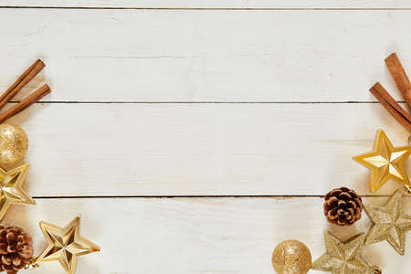 Christmas decoration. wooden background with copy space. Golden balls, stars and brownish aesthetics