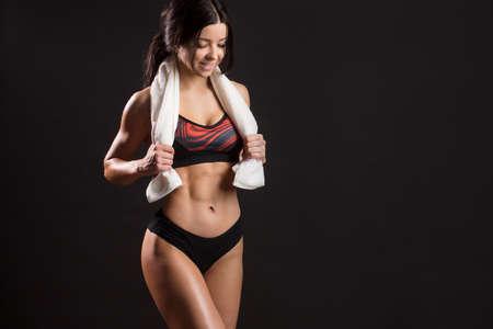 Miss fitness bikini. Beautiful sportive caucasian fitness female posing on studio background. Sport - concept of healthy lifestyle.