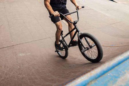 close up Boy riding bmx in a skate park. Beautiful background Stock Photo